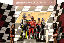 Podium: race winner Casey Stoner with Valentino Rossi and Dani Pedrosa