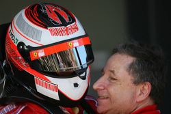 Kimi Raikkonen and Jean Todt celebrate