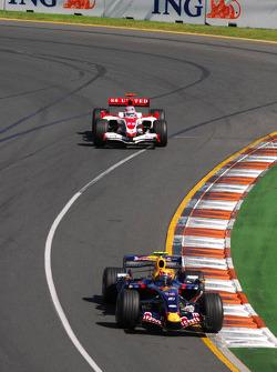 Mark Webber, Red Bull Racing, RB3 and Takuma Sato, Super Aguri F1, SA07