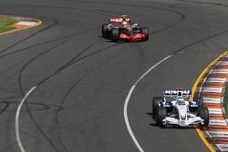 Nick Heidfeld, BMW Sauber F1 Team, F1.07 and Lewis Hamilton, McLaren Mercedes, MP4-22