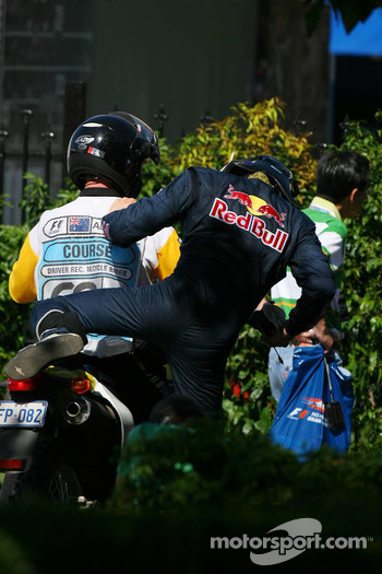 David Coulthard, Red Bull Racing taken back to the paddock on a moped