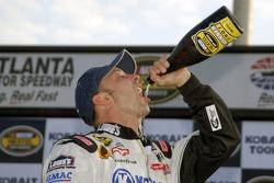 Victory lane: Jimmie Johnson team crew chief Chad Knaus enjoys the winning champagne