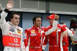 Pole winner Felipe Massa celebrates with Fernando Alonso and Kimi Raikkonen