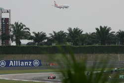Lewis Hamilton, McLaren Mercedes, MP4-22 with an Airliner coming into land in the background