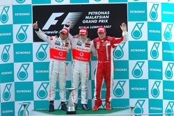 Podium: race winner Fernando Alonso with Lewis Hamilton and Kimi Raikkonen