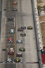 Start: Will Power and Paul Tracy battle for the lead