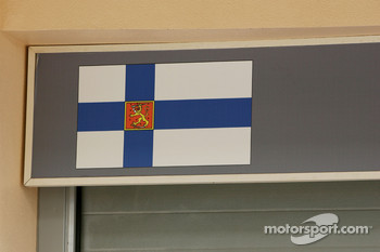Finnish flag above the garage of Kimi Raikkonen, Scuderia Ferrari