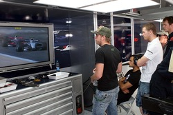 Scott Speed, Scuderia Toro Rosso Vitantonio Liuzzi, Scuderia Toro Rosso and Alex Speed, Brother to Scott Speed, watch the race in the team garage