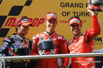 Podium: race winner Casey Stoner with Loris Capirossi and Toni Elias
