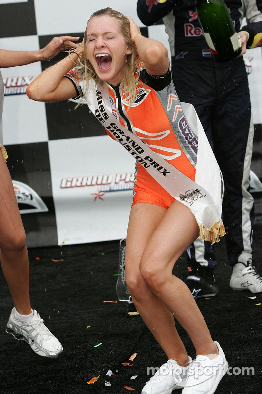 Podium: emotions run high as a Champ Car girl is sprayed with champagne