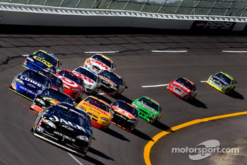 Clint Bowyer leads a group of cars