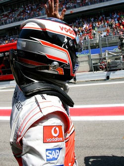 Fernando Alonso, McLaren Mercedes, waves to his fans