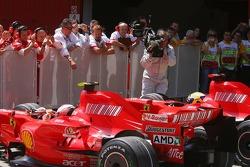 Kimi Raikkonen, Scuderia Ferrari and pole winner Felipe Massa, Scuderia Ferrari in parc ferme