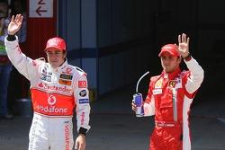 Pole winner Felipe Massa, Scuderia Ferrari, celebrates with Fernando Alonso, McLaren Mercedes