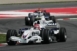 Robert Kubica, BMW Sauber F1 Team, F1.07 leads Nick Heidfeld, BMW Sauber F1 Team, F1.07