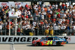 Jeff Gordon takes the checkered flag