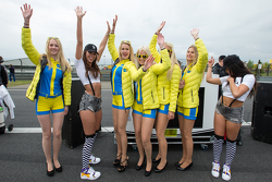 Black Falcon party girls meet the Aston Martin Racing Aston girls on the starting grid