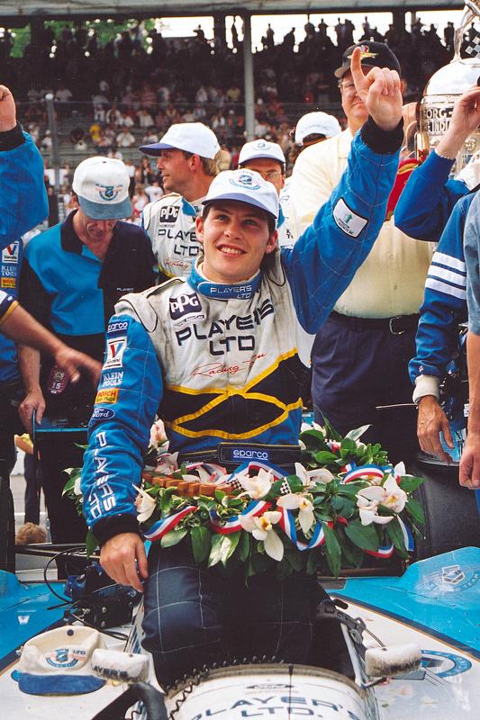 Race winner Jacques Villeneuve celebrates