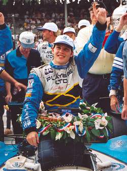 Race winner Jacques Villeneuve celebrates