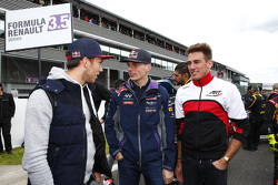 Max Verstappen visits with Pierre Gasly