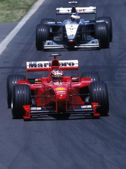 Michael Schumacher, Ferrari and Mika Hakkinen, McLaren