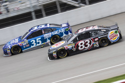 Cole Whitt, Front Row Motorsports Ford and Matt DiBenedetto, BK Racing Toyota