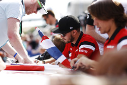 Will Stevens, Manor F1 Team and Roberto Merhi, Manor F1 Team sign autographs for the fans