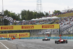 Kevin Ceccon, Arden International, takes the chequered flag ahead of Esteban Ocon, ART Grand Prix and Jimmy Eriksson, Koiranen GP