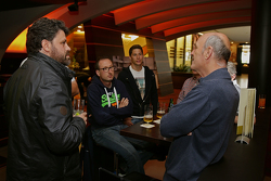Dr. Wolfgang Ullrich, head of Audi Sport enjoys a beer with media and Loic Duval