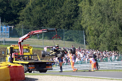The Lotus F1 E23 of Pastor Maldonado, Lotus F1 Team is recovered back to the pits on the back of a truck after he crashed in the first practice session