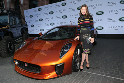 Hannah Herzsprung next to a Jaguar C-X75 during the presentation of the Jaguar Land Rover vehicles starring in the new Bond film Spectre