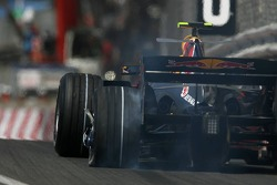 Mark Webber, Red Bull Racing, RB3, has a flat tyre and damaged wheel rim