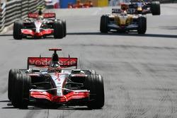 Race winner Fernando Alonso, McLaren Mercedes, MP4-22, 2nd, Lewis Hamilton, McLaren Mercedes, MP4-22