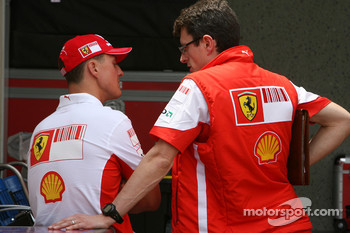 Michael Schumacher, Scuderia Ferrari, Advisor and Chris Dyer, Scuderia Ferrari, Track Engineer of Kimi Raikkonen