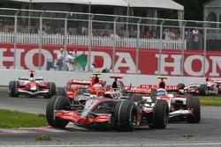 Fernando Alonso, McLaren Mercedes, MP4-22 and Anthony Davidson, Super Aguri F1 Team, SA07
