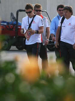 Fernando Alonso, McLaren Mercedes arrives at the track and reads The Red Bulletin