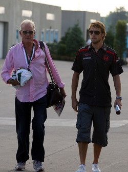 Jenson Button, Honda Racing F1 Team and his father John arrives at the track and reads The Red Bulletin