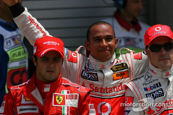 Felipe Massa, Scuderia Ferrari with Lewis Hamilton, McLaren Mercedes gets pole position and Fernando Alonso, McLaren Mercedes