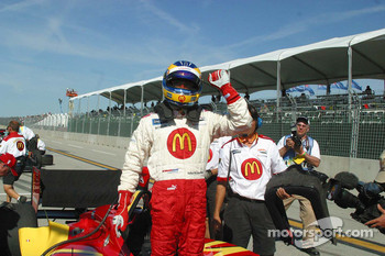 Sébastien Bourdais celebrates winning the provisional pole
