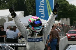 Race winner Bruno Spengler celebrates