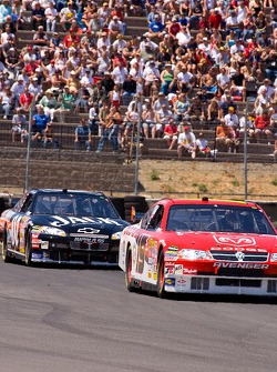 Elliott Sadler chased by Clint Bowyer