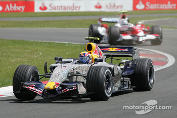 Mark Webber, Red Bull Racing, RB3 and Jarno Trulli, Toyota Racing, TF107