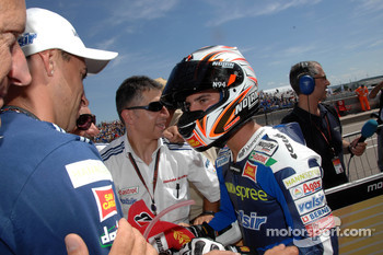 Marco Melandri celebrates third place qualifying