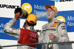Podium: Mattias Ekström, Audi Sport Team Abt Sportsline, gives Mika Hakkinen, Team HWA AMG Mercedes, a champagne shower