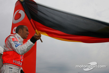 Lewis Hamilton, McLaren Mercedes, Vodafone Karting Event, waves the German national flag
