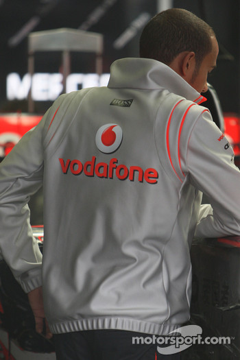 Lewis Hamilton, McLaren Mercedes, returns to the circuit and checks his car after receiving a CT Scan in hospital