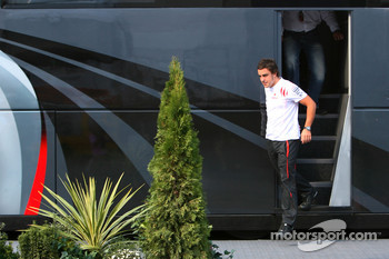 Fernando Alonso and his manager Luis Garcia Abad exit the bus of Bernie Ecclestone