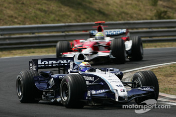 Nico Rosberg, WilliamsF1 Team, FW29 and Ralf Schumacher, Toyota Racing, TF107