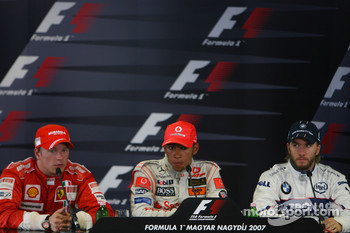 Press conference: race winner Lewis Hamilton with second place Kimi Raikkonen and third place Nick Heidfeld
