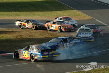 Marcos Ambrose and Robby Gordon battle and crash